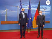 German Foreign Minister Heiko Maas, right, and the US' Special Presidential Envoy for Climate John Kerry, left, pose prior to a meeting at the Foreign Office in Berlin on Tuesday, May 18, 2021.
