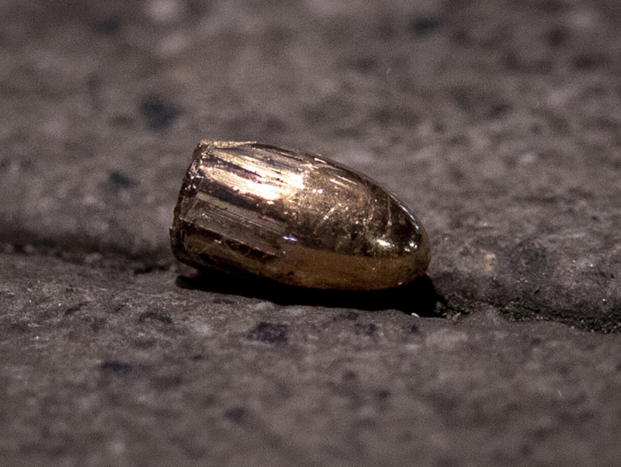 FILE - In this Feb. 19, 2020 file photo, a projectile lies on the sidewalk near a restaurant at the scene of a shooting in central Hanau, Germany. About one year ago a far right man shot nine people before he shot himself. Hanau will commemorate the victims this Friday.
