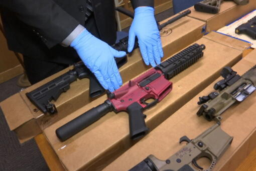 "FILE - In this file photo taken Wednesday, Nov. 27, 2019, is Sgt. Matthew Elseth with ""ghost guns"" on display at the headquarters of the San Francisco Police Department in San Francisco. A federal appeals court in San Francisco has ruled that plans for 3D-printed, self-assembled ""ghost guns"" can be posted online without U.S. State Department approval. The San Francisco Chronicle says the 2-1 decision was made Tuesday, April 27, 2021, by the 9th U.S. District Court of Appeals."