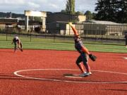 Ridgefield's Maizy Whitlow delivers a pitch against Columbia River in the third-place game of the 2A district softball tournament on Thursday at Recreation Park in Chehalis.