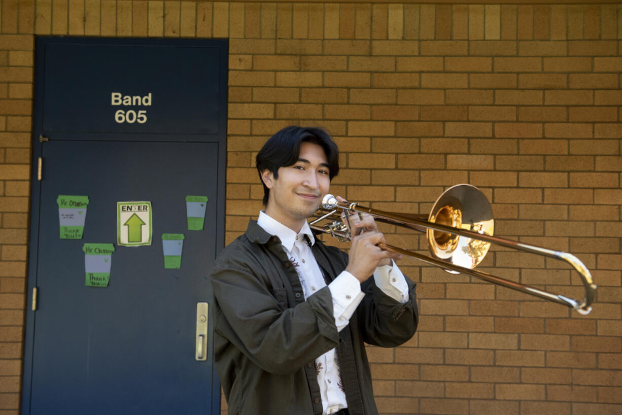 Mountain View High School senior Diego Inzunza pauses for a portrait outside the school's band room.