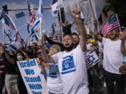 FILE - Pro-Israel supporters chant slogans during a rally in support of Israel outside the Federal Building in Los Angeles, Wednesday, May 12, 2021. A larger debate is playing out nationwide among many U.S. Jews who are divided over how to respond to the violence and over the disputed boundaries for acceptable criticism of Israeli policies. (AP Photo/Jae C.