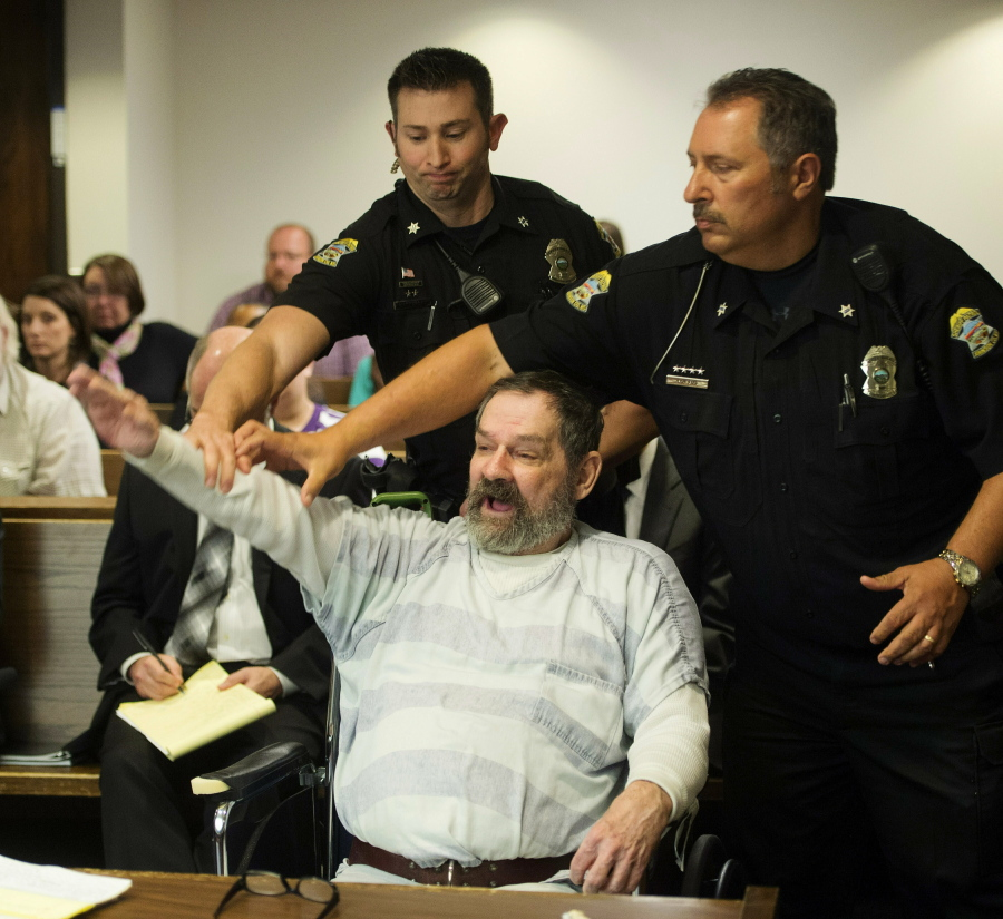 FILE - In this Nov. 10, 2015, file photo, Frazier Glenn Miller Jr., convicted of capital murder, attempted murder and other charges, gestures as Johnson County deputies remove Miller from the courtroom during the sentencing phase of his trial at the Johnson County District Court in Olathe, Kan. Miller, an avowed anti-Semite who fatally shot three people at Jewish sites in Kansas has died in prison, Monday, May 3, 2021, at the El Dorado Correctional Facility.