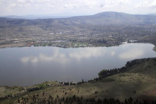 FILE - This May 7, 2013 file photo shows Klamath Falls, in Ore. on the far side of Upper Klamath Lake. A federal judge has ruled against the Klamath Tribes in a lawsuit that accuses the U.S. Bureau of Reclamation of violating the Endangered Species Act by letting water levels fall too low for sucker fish to spawn in a key lake that also feeds an elaborate irrigation system along the Oregon-California border. The ruling, reported Friday, May 7, 2021, by the Herald and News in Klamath Falls, comes as the region confronts one of the driest years in memory.