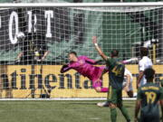 A ball kicked by Portland Timbers forward Felipe Mora (9) makes it past LA Galaxy goalkeeper Jonathan Bond (1) during the second half of an MLS soccer match, Saturday, May 22, 2021, in Portland, Ore. Portland Timbers won 3-0.