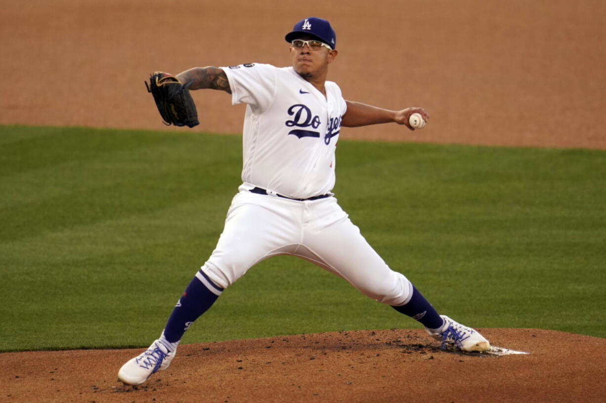 Los Angeles Dodgers starting pitcher Julio Urias throws to a Seattle Mariners batter during the first inning of a baseball game Wednesday, May 12, 2021, in Los Angeles.