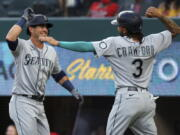 Seattle Mariners' Dylan Moore (25) celebrates his two-run home run with J.P. Crawford (3) during the second inning against the Texas Rangers in a baseball game Friday, May 7, 2021, in Arlington, Texas. (AP Photo/Richard W.