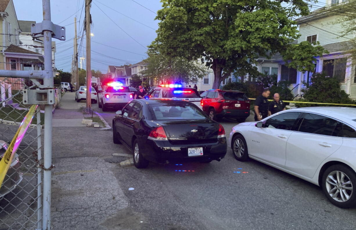 Authorities respond to the scene where multiple people were wounded in a shooting, Thursday, May 13, 2021, in Providence, R.I. (AP Photo/William J.