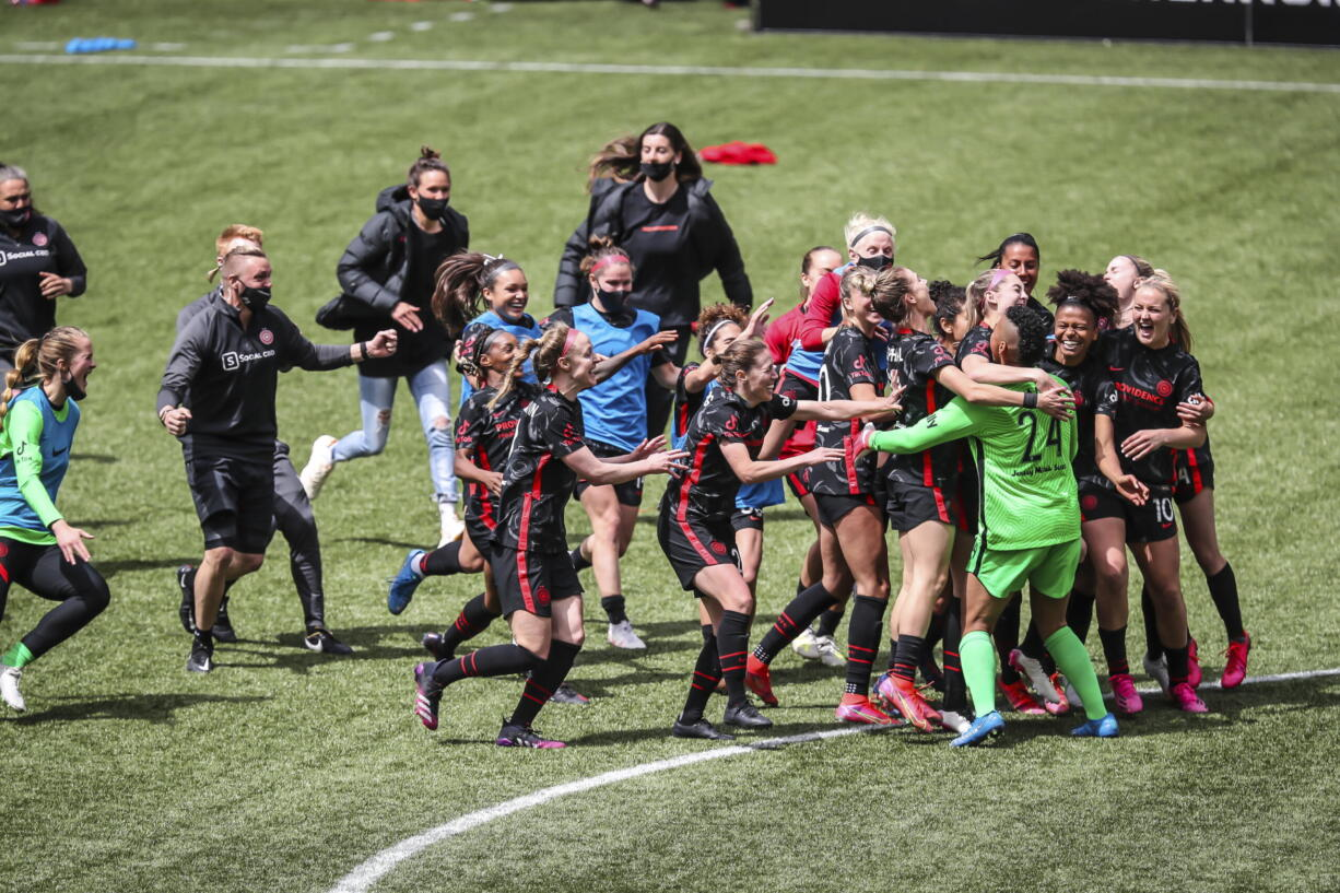 Portland Thorns goalkeeper AD Franch (24) joins the celebration after defeating NJ/NY Gotham FC in the NWSL Challenge Cup soccer final at Providence Park, Saturday, May 8, 2021, in Portland, Ore.