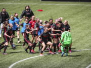 Portland Thorns goalkeeper AD Franch (24) joins the celebration after defeating NJ/NY Gotham FC in the NWSL Challenge Cup soccer final against NJ/NY Gotham FC at Providence Park, Saturday, May 8, 2021, in Portland, Ore.