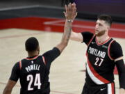 Portland Trail Blazers forward Norman Powell, left, celebrates with center Jusuf Nurkic, right, during the second half of Game 4 of an NBA basketball first-round playoff series against the Denver Nuggets in Portland, Ore., Saturday, May 29, 2021. The Blazers won 1115-95.