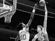 Mark Eaton (53), the 7-foot-4 shot-blocking king who twice was the NBA's defensive player of the year during his career with the Utah Jazz, has died, the team said Saturday, May 29, 2021. He was 64. (AP Photo/R.J.