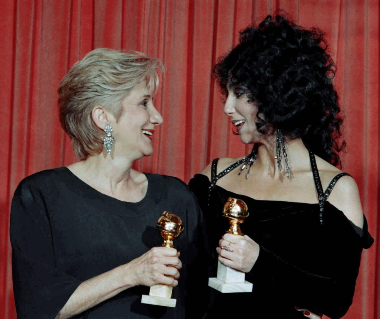 "Actress Olympia Dukakis, winner of a Golden Globe for ""Best Performance in a Supporting Role"" and Cher, winner of the ""Best Performance by an Actress in a musical or comedy"", hold the awards they received for performances in the hit movie ""Moonstruck"" at the Beverly Hilton Hotel. Olympia Dukakis, the veteran stage and screen actress whose flair for maternal roles helped her win an Oscar as Cher's mother in the romantic comedy ""Moonstruck,"" has died. She was 89."