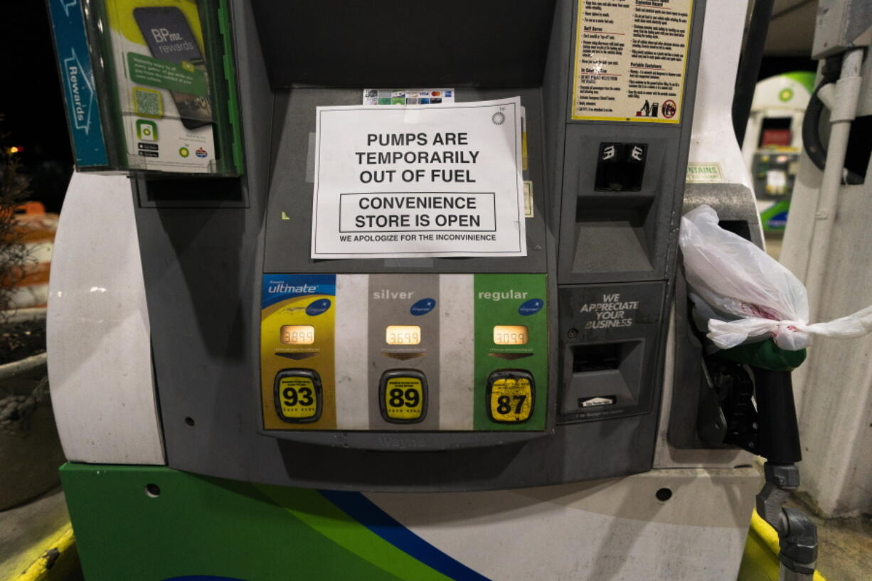 """A gas pump at a gas station in Silver Spring, Md., is out of service, notifying customers they are out of fuel, late Thursday, May 13, 2021. Motorists found gas pumps shrouded in plastic bags at tapped-out service stations across more than a dozen U.S. states Thursday while the operator of the nation's largest gasoline pipeline reported making """"substantial progress"""" in resolving the computer hack-induced shutdown responsible for the empty tanks."""