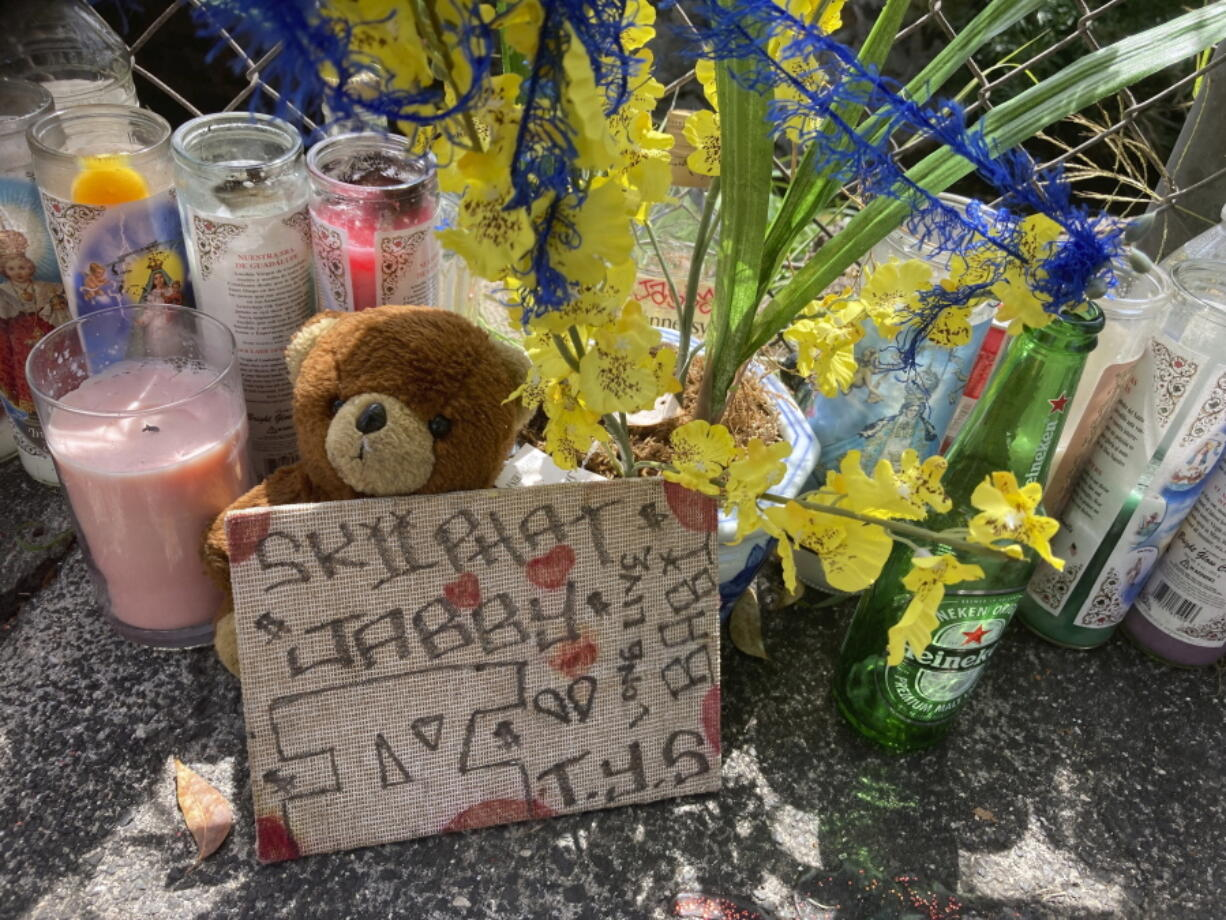 In this Wednesday, April 28, 2021, photo a stuffed bear is among the items left at a street memorial where Honolulu Police shot and killed 16-year-old Iremamber Sykap, whose nickname was Baby, during a car chase on Kalakaua Ave., in Honolulu. Some in Hawaii's Micronesian community say the shooting highlights the racism they face.