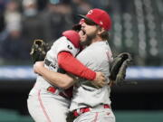 Cincinnati Reds starting pitcher Wade Miley, right, is congratulated by catcher Tucker Barnhart after pitching a no-hitter against the Cleveland Indians in a baseball game, Friday, May 7, 2021, in Cleveland.