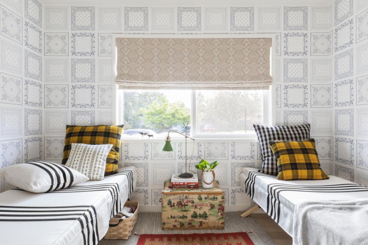 This image released by Portland Oregon-based interior designer Max Humphrey shows a room with a wallpaper design inspired by  bandanas.