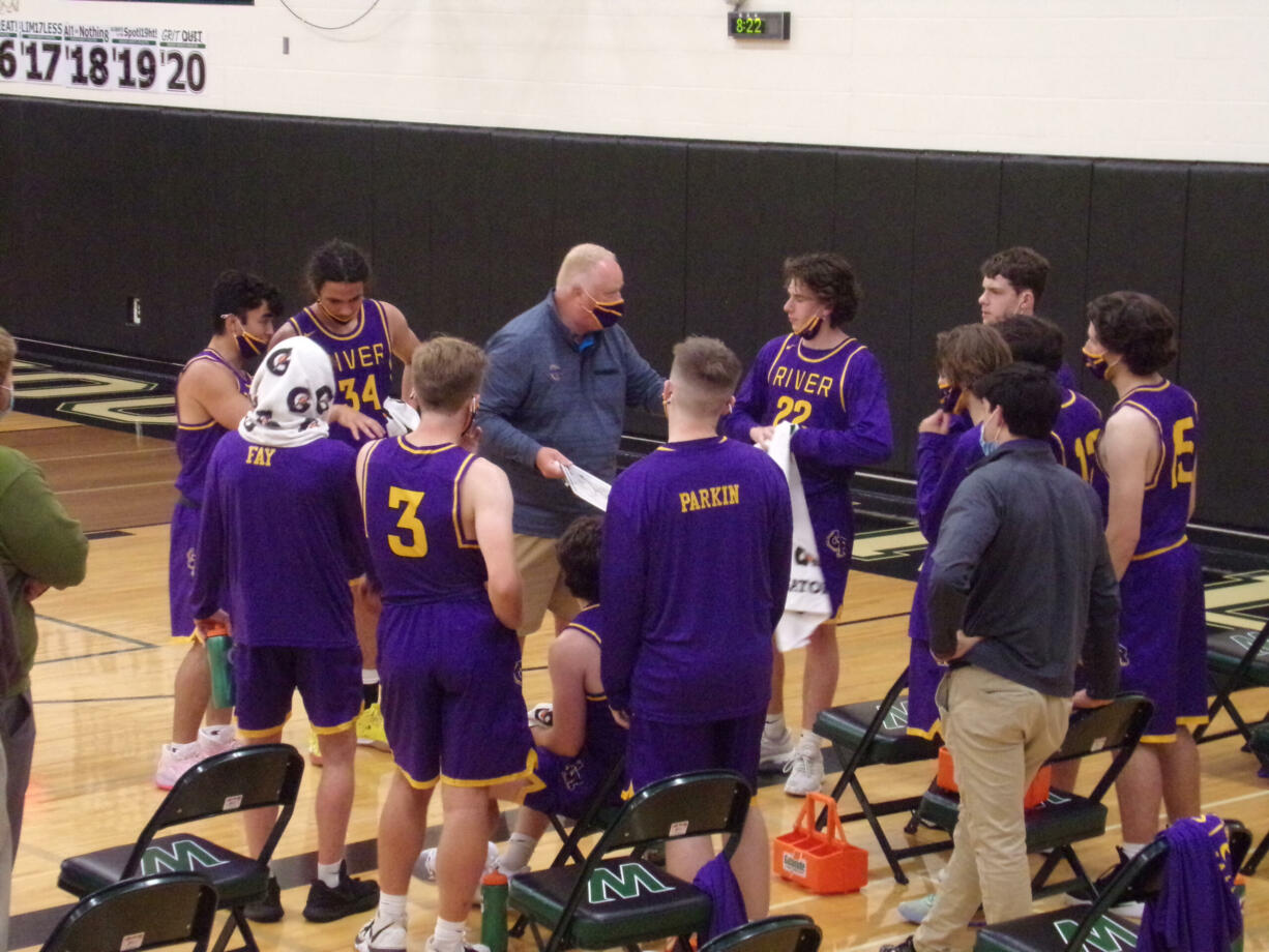 Columbia River coach David Long instructs Jacob Ayers (22) during a timeout in River's 57-43 win over Woodland on Tuesday, May 18, 2021 (Tim Martinez/The Columbian)