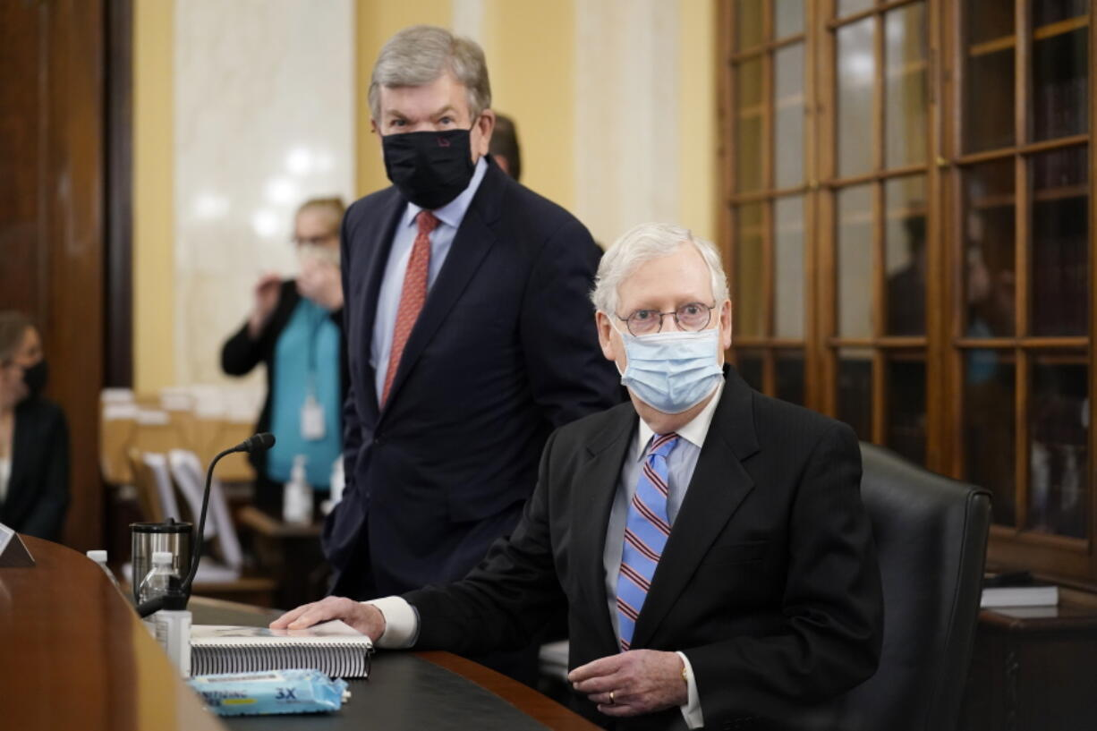 Senate Minority Leader Mitch McConnell of Ky., right, and Sen. Roy Blunt, R-Mo., arrive for a Senate Rules Committee hearing at the Capitol in Washington, Tuesday, May 11, 2021. (AP Photo/J.
