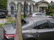 A utility pole rests on a 2020 Toyota Camry smashing the back window after powerful storms rolled through the city overnight, in New Orleans Wednesday, May 12, 2021.