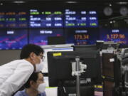 Currency traders watch monitors at the foreign exchange dealing room of the KEB Hana Bank headquarters in Seoul, South Korea, Tuesday, May 4, 2021. Asian shares were mixed Tuesday after strong corporate earnings and economic data lifted stocks on Wall Street.