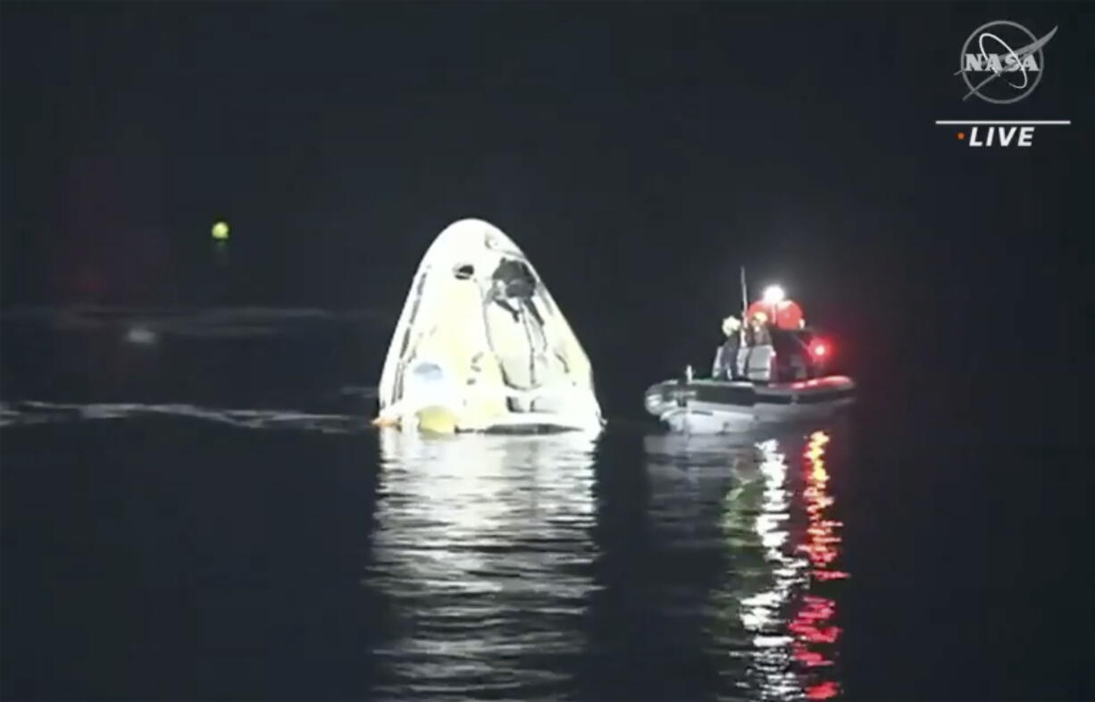 In this image made from NASA TV video, the SpaceX Dragon capsule floats after landing in the Gulf of Mexico near the Florida Panhandle early Sunday, May 2, 2021. SpaceX returned four astronauts from the International Space Station on Sunday, making the first U.S. crew splashdown in darkness since the Apollo 8 moonshot.