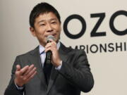 FILE - In this Nov. 20, 2018, file photo, Zozo Chief Executive Yusaku Maezawa speaks during a press conference on the PGA Tour in Tokyo.  The Japanese fashion tycoon who's booked a SpaceX ride to the moon is going to try out the International Space Station first.  Maezawa announced Thursday, May 13, 2021,  that he's bought two seats on a Russian Soyuz capsule.