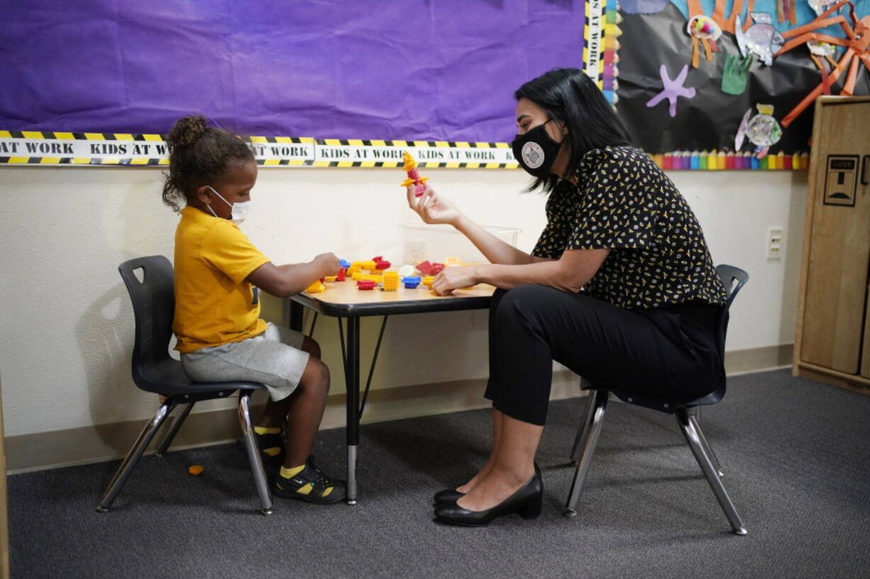Teacher Juliana Urtubey, right, interacts with Kamari Wolfe in a class at Kermit R Booker Sr Elementary School Wednesday, May 5, 2021, in Las Vegas. Urtubey is the the 2021 National Teacher of the Year.