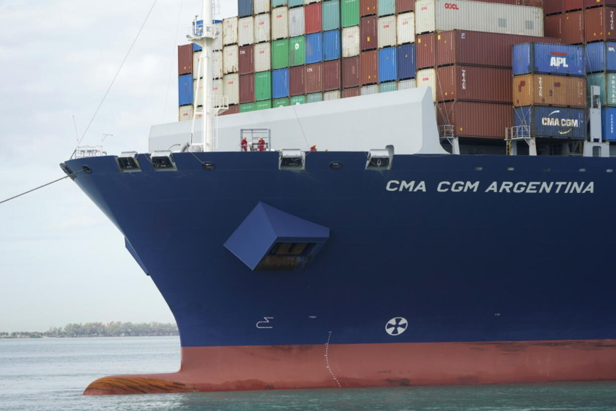 Crew members stand on the bow as the CMA CGM Argentina arrives at PortMiami, the largest container ship to call at a Florida port, Tuesday, April 6, 2021, in Miami.  The U.S. trade deficit grew to $71.1 billion in February, as a decline in exports more than offset a slight dip in imports. The February gap between what America buys from abroad compared to what it sells abroad jumped 4.8% the revised January deficit of $67.8 billion.vThe increase reflected a 2.6% decline in exports of goods and services to $187.3 billion on a seasonally adjusted basis.