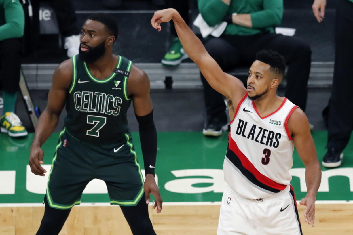 Portland Trail Blazers' CJ McCollum (3) shoots a 3-pointer against Boston Celtics' Jaylen Brown (7) during the second half of an NBA basketball game, Sunday, May 2, 2021, in Boston.