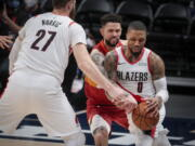 Portland Trail Blazers center Jusuf Nurkic (27) sets a screen against Denver Nuggets guard Austin Rivers as Rivers fouls Trail Blazers guard Damian Lillard (0) in the second quarter of Game 2 of a first-round NBA basketball playoff series Monday, May 24, 2021, in Denver.