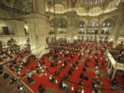 Muslims offer prayers during the first day of Eid al-Fitr, which marks the end of the holy month of Ramadan at Fatih Mosque in Istanbul, Thursday, May 13, 2021. Hundreds of Muslims attended dawn Eid al-Fitr prayers Thursday marking the end of the month of prayer and fasting for Muslims around the world, a usually joyous three-day celebration that has been significantly toned down as coronavirus cases soar.