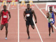 Seattle Seahawks wide receiver DK Metcalf, center, competes in the second heat of the men's 100-meter dash prelim during the USATF Golden Games at Mt. San Antonio College Sunday, May 9, 2021, in Walnut, Calif. At left is Felipe Bardi Dos Santos and at right is Abdullah Mohammed.