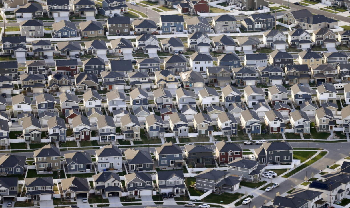 FILE - Rows of homes, are shown in suburban Salt Lake City, on April 13, 2019. Utah is one of two Western states known for rugged landscapes and wide-open spaces that are bucking the trend of sluggish U.S. population growth. The boom there and in Idaho are accompanied by healthy economic expansion, but also concern about strain on infrastructure and soaring housing prices.