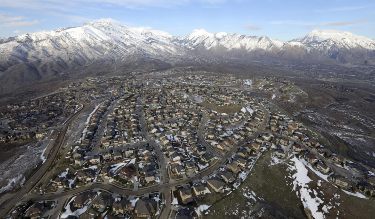 FILE - Rows of homes, in suburban Salt Lake City, on April 13, 2019. Utah is one of two Western states known for rugged landscapes and wide-open spaces that are bucking the trend of sluggish U.S. population growth. The boom there and in Idaho are accompanied by healthy economic expansion, but also concern about strain on infrastructure and soaring housing prices.