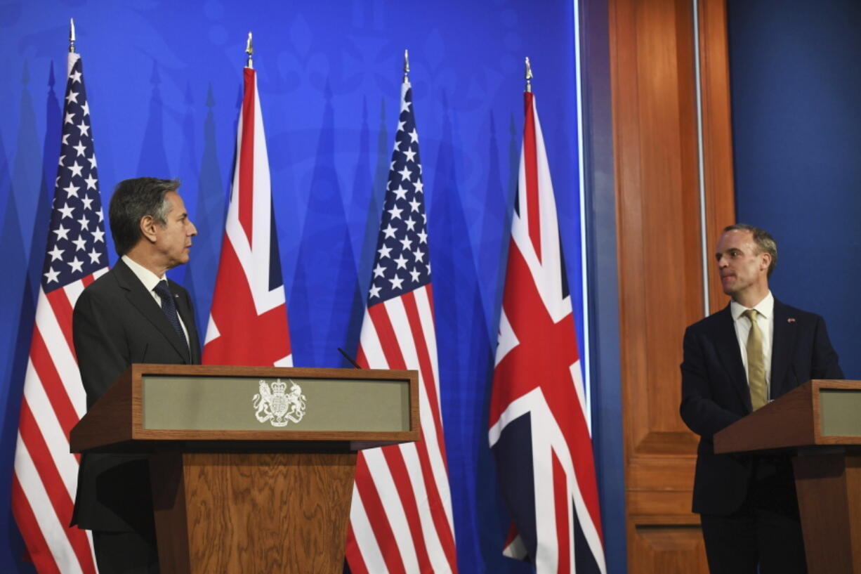 In this May 3, 2021, photo, Britain's Foreign Secretary Dominic Raab, right, and U.S. Secretary of State Antony Blinken speak at a news conference at Downing Street in London. A flurry of diplomatic activity and reports of major progress suggest that indirect talks between the U.S. and Iran may be nearing a conclusion. That's despite efforts by U.S. officials to play down chances of an imminent deal that would bring Washington and Tehran back into compliance with the 2015 nuclear deal.  (Chris J.
