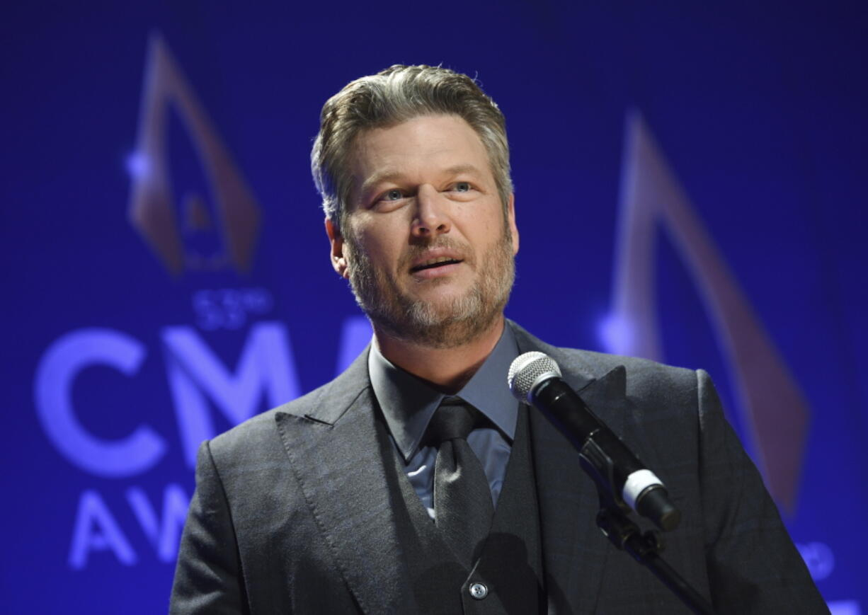 """FILE - In this Nov. 13, 2019, file photo, singer Blake Shelton speaks in the press room after winning single of the year award for """"God's Country"""" at the 53rd annual CMA Awards at Bridgestone Arena in Nashville, Tenn. The CMA will provide 4 million meals in cities with large populations of musicians and music industry professionals in partnership with Feeding America, and will also launch a donation challenge to fund  additional meals through its MICS Covid-19 initiative Monday, May 10, 2021. Shelton said he is proud to be part of the initiative and drumming up more support to raise funds for the food banks."""