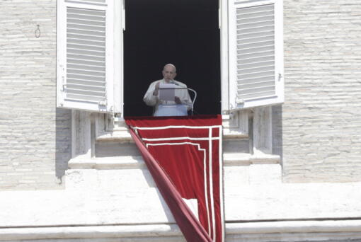 Pope Francis recites the Angelus noon prayer in St. Peter's Square at the Vatican, Sunday, May 9, 2021.