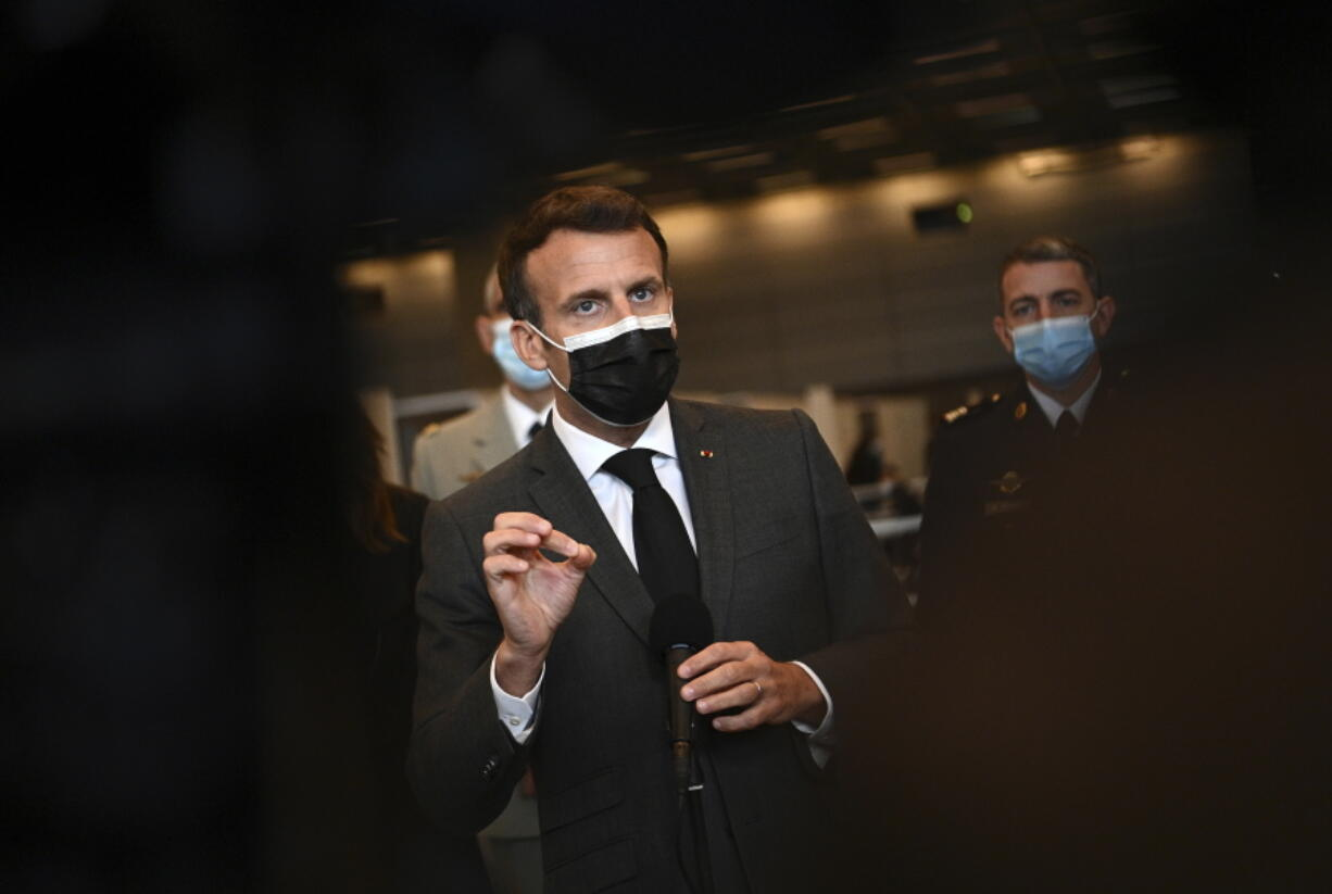 French President Emmanuel Macron talks to the press as he visits a giant vaccination center against the Covid-19 during its inauguration at Porte de Versailles convention centre in Paris, Thursday, May 6, 2021.