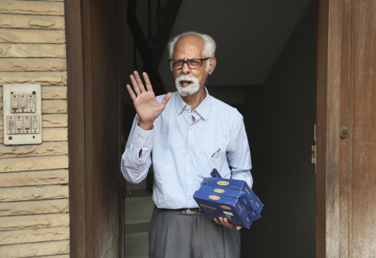 FILE - In this Nov. 8, 2020, file photo, Vice President Kamala Harris' maternal uncle, Balachandran Gopalan, talks to media outside his house, in New Delhi, India.