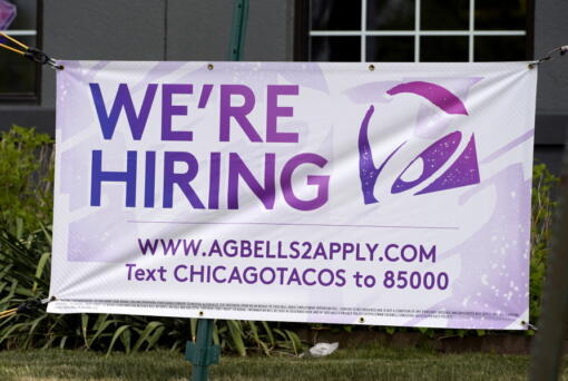 A hiring sign is displayed outside of a restaurant during the COVID-19 pandemic in Glenview, Ill., Saturday, May 8, 2021. US job growth slows sharply in sign of hiring struggles. Employers added just 266,000 jobs in April, sharply lower than in March and far fewer than economists had expected. The unemployment rate rose for the first time since April 2020. (AP Photo/Nam Y.