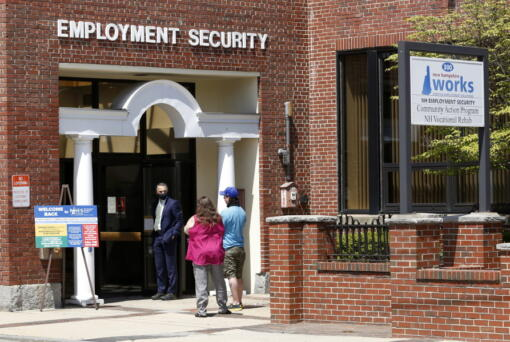 Job seekers line up outside the New Hampshire Works employment security job center, Monday, May 10, 2021, in Manchester, N.H. States are pushing the unemployed to get back to work to help businesses large and small find the workers they need to emerge from the COVID-19 recession. Now some states are reinstating a requirement that anyone who collects unemployment must look for work.