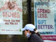 Signs about Mother's Day are displayed at a home decor department store in Northbrook, Ill., Saturday, May 8, 2021. (AP Photo/Nam Y.