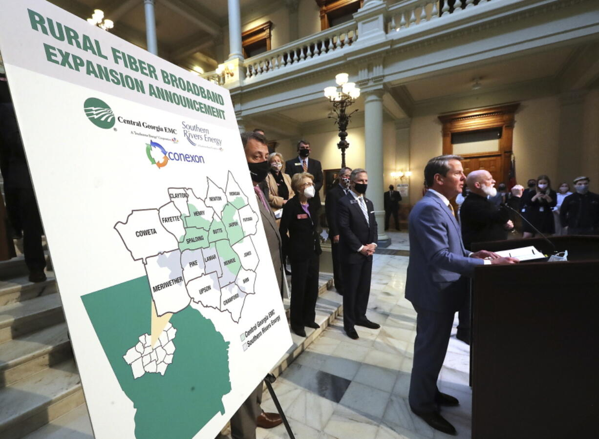 FILE - In this Monday, Feb 8, 2021 file photo, Gov. Brian Kemp speaks during a news conference about expanding rural internet access in the state, at the Georgia Capitol in Atlanta. The federal American Rescue Plan, comes on top of $150 billion the federal government sent directly to states and local governments in 2020. This year's law cites infrastructure for water, sewer and broadband internet as allowable uses.