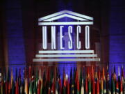 FILE - In this Nov.4, 2017 file photo, the logo of the United Nations Educational, Scientific and Cultural Organisation (UNESCO) is seen during the 39th session of the General Conference at the UNESCO headquarters in Paris. While the U.S. president is calling for suspending patents on COVID-19 vaccines, experts at UNESCO are quietly working on a more ambitious plan: a new global system for sharing scientific knowledge that would outlast the current pandemic.
