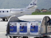"""FILE - In this May 4, 2021, file photo, a container with boxes of the Pfizer vaccine for COVID-19 is delivered at the Sarajevo Airport, Bosnia. The head of the World Trade Organization said Friday, May 7, the U.S. administration's call to remove patent protections on COVID-19 vaccines could help expand fair access to vaccines but might not be the most """"critical issue,"""" as officials in Europe increasingly insisted that more vaccine exports are the more pressing priority."""