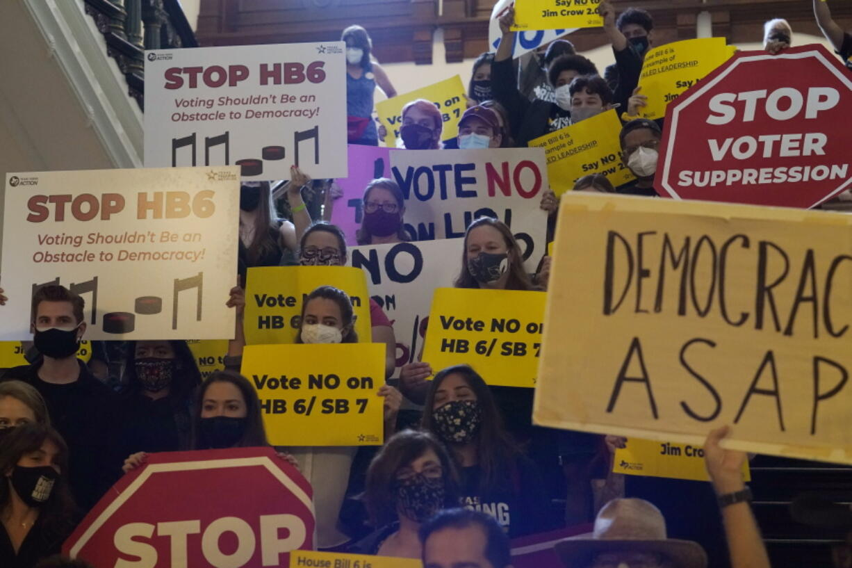 FILE - In this May 6, 2021 file photo, a group opposing new voter legislation gather outside the House Chamber at the Texas Capitol in Austin, Texas.