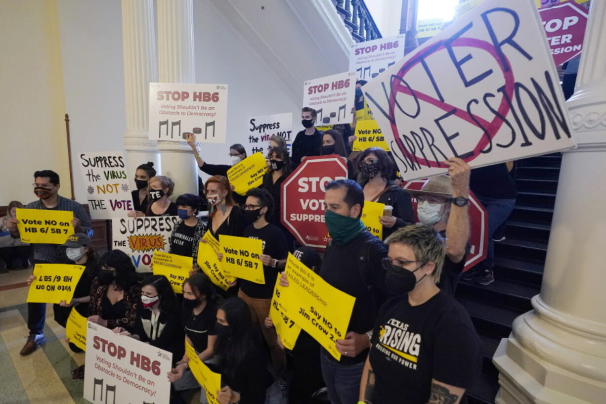 FILE - In this May 6, 2021, file photo, a group opposing new voter legislation gather outside the House Chamber at the Texas Capitol in Austin, Texas. In 2020, election officials tried to make voting easier and safer amid a global pandemic. Next time, they might get fined or face criminal charges.