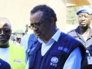 FILE - In this file photo dated Friday, Aug. 10, 2018, Dr. Tedros Adhanom Ghebreyesus, WHO Director General, speaks to a health official at a newly established Ebola response center in Beni, Democratic Republic of Congo. British, European and American diplomats and donors have voiced serious concerns about how the World Health Organization handled sex abuse allegations involving their own staff during an outbreak of Ebola in Congo.