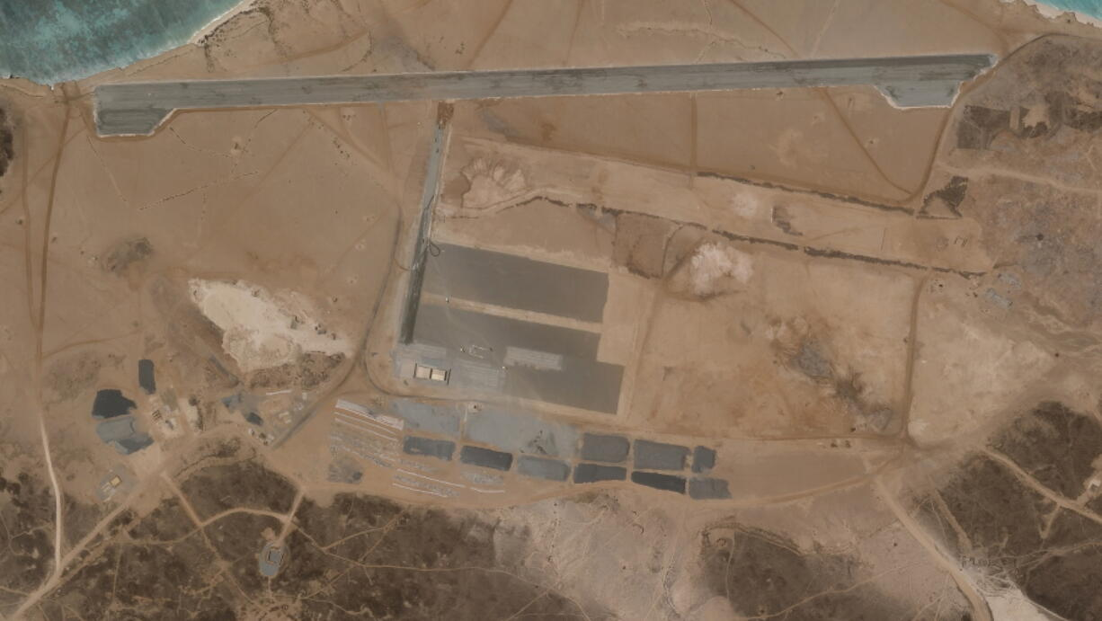 A mysterious air base is seen being built on Yemen's volcanic Mayun Island in this April 11, 2021 satellite photograph from Planet Labs Inc. The air base is in one of the world's crucial maritime chokepoints for both energy shipments and commercial cargo. Officials in Yemen's internationally recognized government say the United Arab Emirates is behind the effort. (Planet Labs Inc.